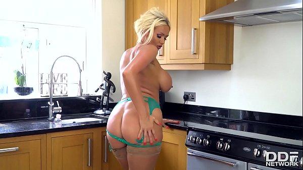 Busty blonde Milf oils her stunning body on the kitchen floor